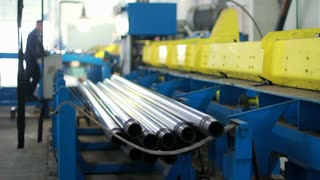 Workflow at the factory. Steel pipes production line. Production process at manufacturing plant. Manufacturing line of stainless steel pipes. Industrial equipment at factory. Heavy industry