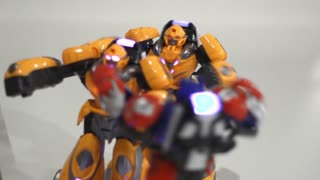 Yellow robots boxing. Close up of battle robot. Two robot fight. Fighting robots toy. Toy robot attack. Small robot fighting. Futuristic game concept