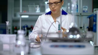 Young woman scientist preparing for laboratory working. Female scientist preparing. Young researcher in lab. Scientist in lab. Woman in lab coat. Scientist woman in science laboratory