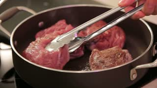 Beef steak fried in pan