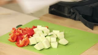 Cheff Is Cutting Cherry Tomatoes, Zucchini and Red Paprika