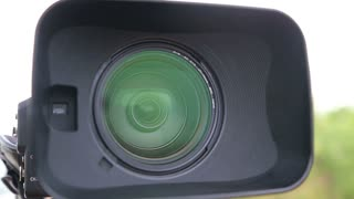 Close up of Digital Video Camera Lens with a Hood