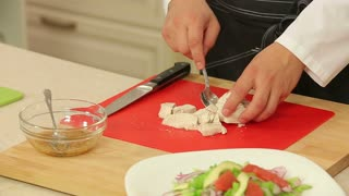Cooking hot salad with chicken meat