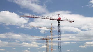 Cranes Staying Still on Construction Site Under Cloudy Sky Timelapse