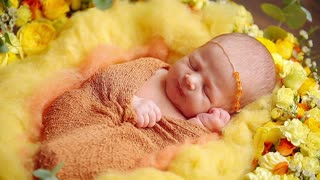 Cute newborn baby girl laying in flowers falling asleep