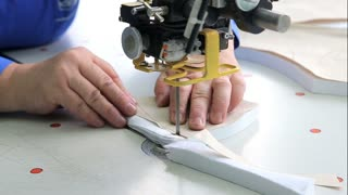 Female worker cutting templates