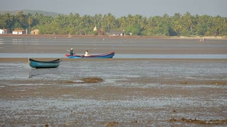 Fisherman boat by river sandbank