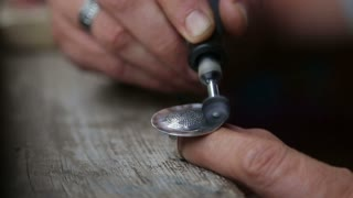 Goldsmith Polishing Silver Ring with Grinder
