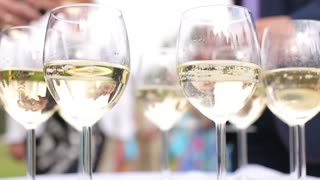 People take glasses of sparkling white wine