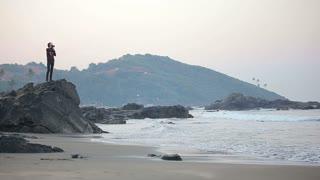 Photographer enjoys early morning seascape