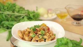 Presentation of Hot Salad with Roasted Chiken Fillet and Vegetables