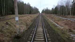 Railroad track running through coutry landscapes