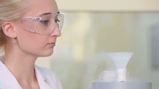 Researcher working with liquid nitrogen