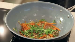 Stir Fry Asian Cuisine Vegetables with Sesame Seeds in a Wok