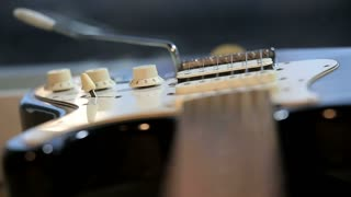 Strings of guitar in close-up