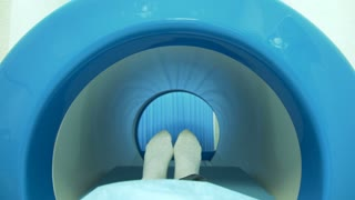 A patient moving into mri scan machine