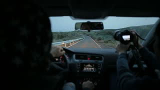 Driving a car on the mountain road