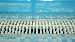 Empty swimming pool tiled floor and drainage