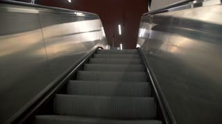 Going up by escalator to the train platform