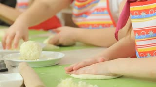 Kids work with dough