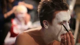 Makeup artist at work applying halloween makeup