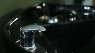 Man's hand opening water tap