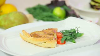 Onion pie garnished with cherry tomatoes