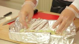 Preparing fish fillet for baking