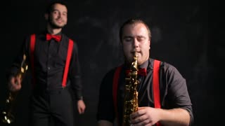 Saxophone and trumpet players vintage retro style