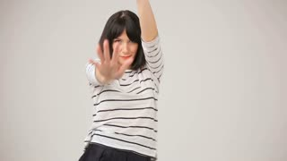 Young brunette smiling and dancing