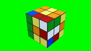 Rubik cube being solved on a green screen