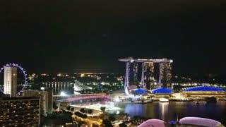 SINGAPORE - May 6, 2017: Nighttime aerial panorama across the Singapore bay, from the Marina Bay Sands luxury hotel, shopping mall and casino to the Financial and Business District.