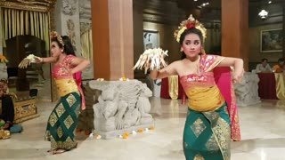 UBUD, BALI, INDONESIA - MAY 11, 2017: Dancers in traditional Balinese costumes perform the Ramayana Hindu Story dance with codified hand positions and eye movements.