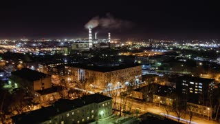 Cityscape with thermal power plant at night, time lapse, Russia