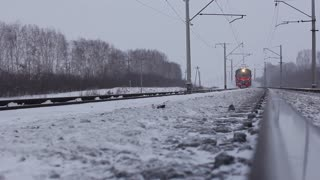 Moving passenger train in winter