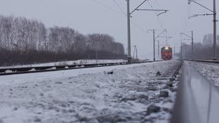 Moving passenger train in winter