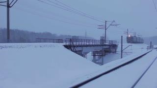 Passenger Train in movement on the bridge