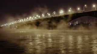 Road bridge and rising mist over the river Yenisei in the night light, Time Lapse Of Bridge In Winter, Krasnoyarsk, Russia