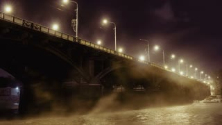 Road bridge and rising steam over the river Yenisei in the night light, Time Lapse Of Bridge In Winter, Krasnoyarsk, Russia