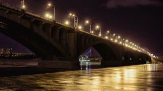 Road bridge over Yenisei River in the Russian Siberian city of Krasnoyarsk at the night, Time Lapse of Communal Night Bridge