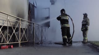 Russian Firefighters extinguish a truck