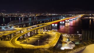 Time lapse of night traffic on the bridge across the river Yenisei, Russia, Krasnoyarsk