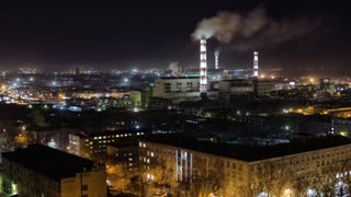 Time lapse of Thermal power plant in the city at night