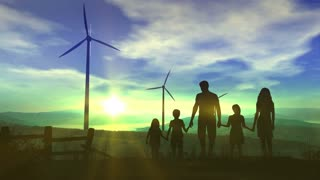 Family on the background of wind power plants and the energy of the future