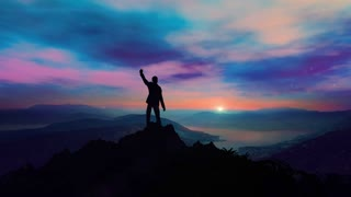 Silhouette of a successful businessman on top of a mountain
