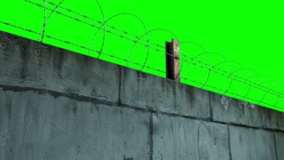 barbed wire and concrete wall greenscreen