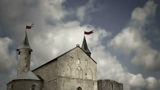 Digitally created medieval castle or church and timelapse clouds. Dark version
