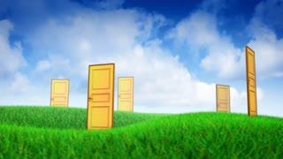 Multiple doors on grass fieldMultiple doors on grass field
