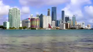 Time lapse tilt shift of Miami Florida water and high rise buildings