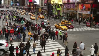 New York City. Cars and Crowd at the Intersection